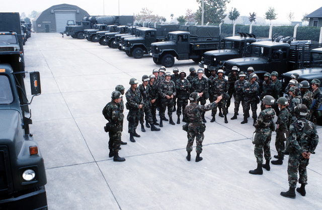 Drivers muster in the motor pool after arriving from Torrejon Air Base, Spain with the equipment of the 401st Tactical Fighter Wing (401st TFW). The 401st TFW has deployed to Aviano for a Salty Nation exercise
