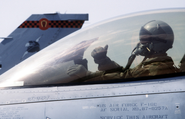"""The pilot of a 401st Tactical Fighter Wing (401st TFW) F-16C Fighting Falcon aircraft signals """"thumbs up"""" as he prepares to taxi onto the runway. The 401st TFW has deployed to Aviano from Torrejon Air Base, Spain, for a Salty Nation exercise"""