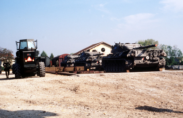 Three Italian army Leopard 1 main battle tanks sit in a staging area at the Aviano rail yard as U.S. Air Force personnel from the 401st Tactical Fighter Wing arrive from Torrejon Air Base, Spain, for a Salty Nation exercise that will be held at Aviano Air Base