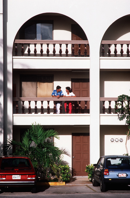 A1C Paula Heath and her husband, SRA Mike Heath, relax on the balcony of their apartment complex near Andersen Air Force Base