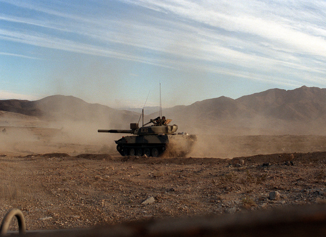 An Opposing Forces (OpFor) M-551 Sheridan light tank visually modified to resemble a Soviet T-72 main battle tank moves forward in an attack on the Blue Forces during an exercise