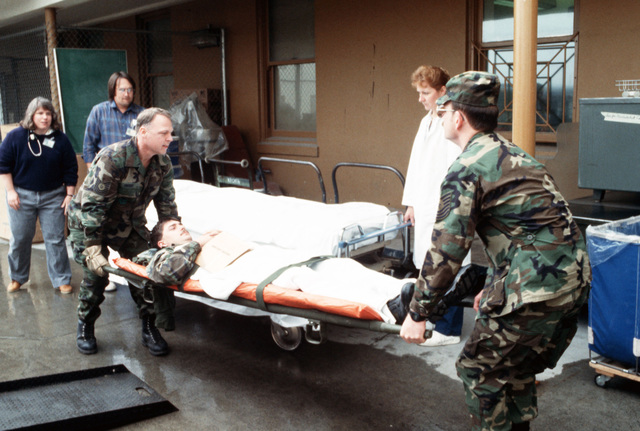 Members of the Alaska Army National Guard transport an earthquake victim by litter during a medical evacuation exercise