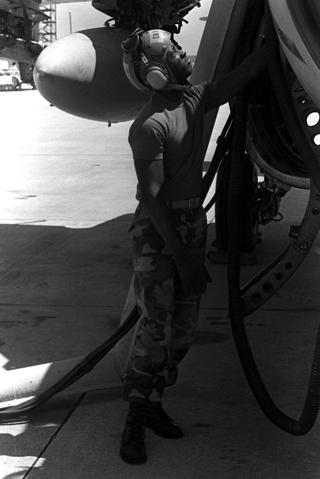 A member of Marine Attack Squadron 224 (VMA-224) services an A-6E Intruder aircraft