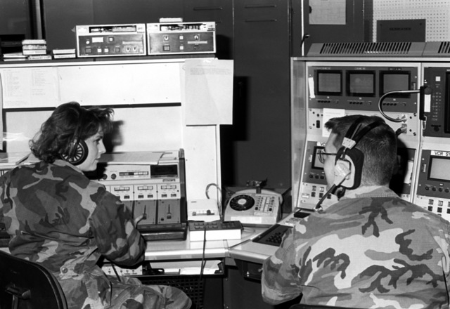 CPL B. Johnson, right, assists LCPL G. Riench with audio clues for the news broadcast at Far East Network, Iwakuni