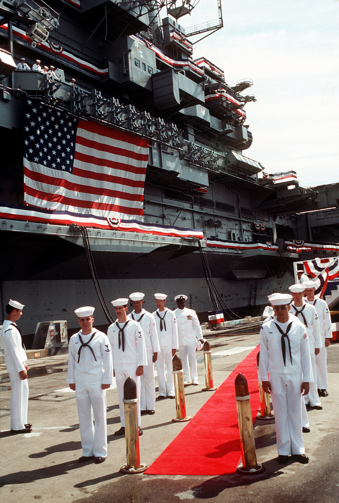 Side boys stand by for the arrival of ranking officers and other guests who will be seated on the speakers plateform during the decommissioning ceremony for the aircraft carrier USS Coral Sea (CV-43). The Coral Sea is being decommissioned after nearly 43 years of service