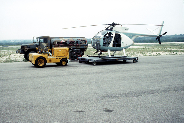 A Hughes 500 commercial helicopter is positioned on a trailer in preparation for transportation to another site. The helicopter is being used during Operation Alliance, a project of Joint Task Force 6 (JTF-6), the unit charged with monitoring borders between Texas, New Mexico, Arizona and Mexico. The U.S. Combat Pictorial Detachment is providing photographic coverage as part of the 5th Army's involvement in the operation