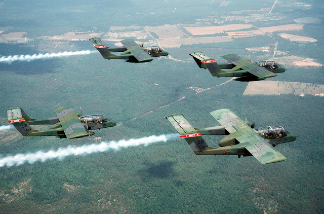 Four OV-10A Bronco aircraft, three of them trailing smoke, fly in a diamond formation during flight out of Shaw Air Force Base, S.C. The aircraft are assigned to the 20th Tactical Air Support Squadron