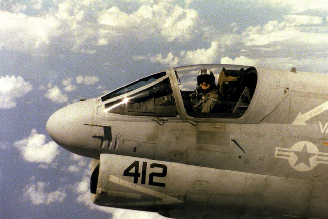 Lieutenant Commander Bud Warfield smiles from the cockpit of an Attack Squadron 72 (VA-72) A-7E Corsair II aircraft while flying over the Caribbean Sea