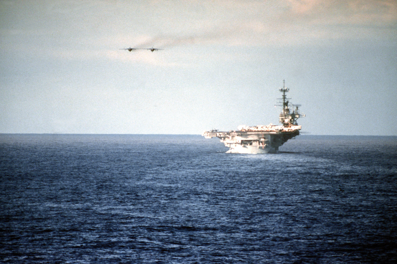 Two A-6E Intruder aircraft fly side by side past the aircraft carrier USS INDEPENDENCE (CV-62) during the multinational Exercise RimPac '90. The Pacific Rim nations of Australia, Canada, Japan, South Korea and the U.S. are participating in the annual naval and amphibious exercise