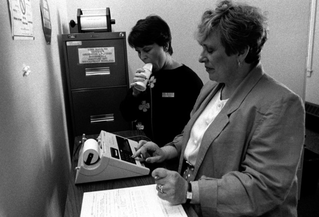 Two employees of the Directorate of Occupational Health and Preventive Medicine (DOH/PM) environmental health division conduct a demonstration of a machine used to check the respiratory system. DOH/PM, which is based at the hospital, provides health services for the 75 commands in the Rhode Island/southeastern Massachusetts area