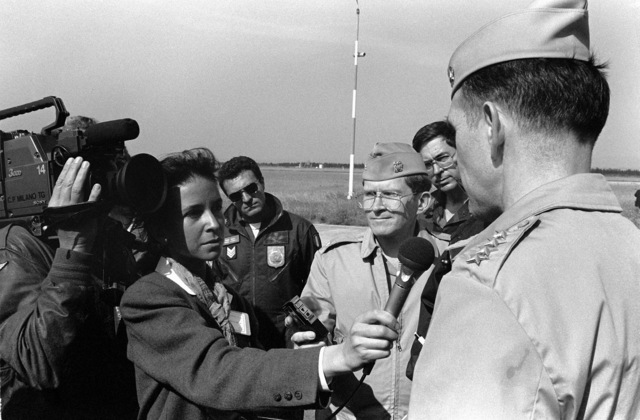 Admiral (ADM) Jonathan T. Howe, right, Commander in CHIEF, Allied Forces Southern Europe, talks to members of the press while visiting a static display of NATO aircraft. The display is being held in conjunction with the NATO Southern Region exercise DRAGON HAMMER '90