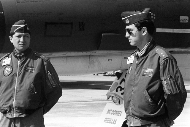 Two Turkish air force pilots stand beside one of the aircraft being shown at a static display of NATO aircraft. The display is being held in conjunction with the NATO Southern Region exercise DRAGON HAMMER '90