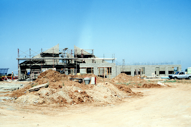 A view of an unaccompanied enlisted quarters (UEQ) under construction. The additional accommodations are being built in anticipation of the movement of units from Mather Air Force Base, California to Beale