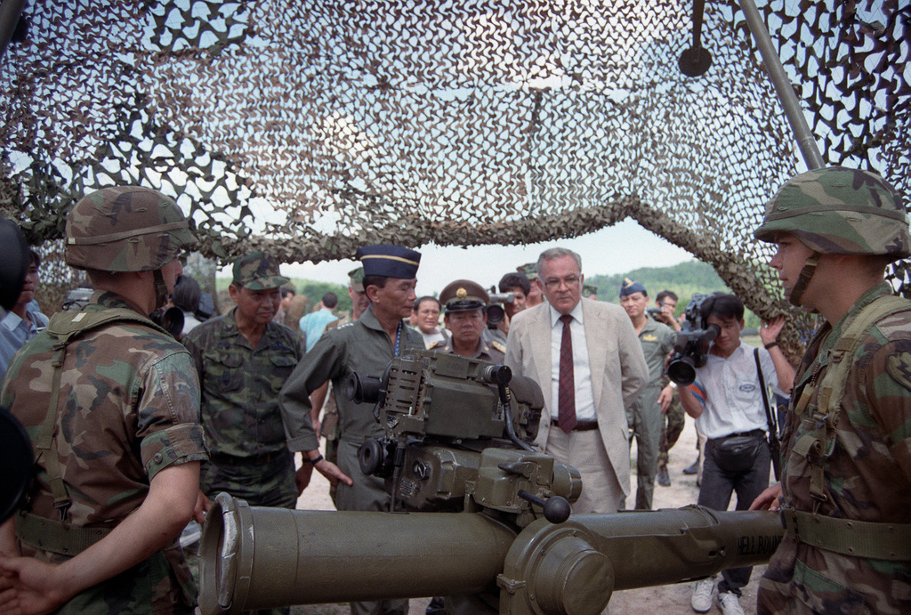 GEN Sundhara Kongsompong, left center, Supreme Commander, Royal Thai Armed Forces, and U.S. Ambassador to Thailand Daniel A. O'Donohue, center right, view a TOW tube-launched, optically tracked, wire-guided heavy anti-tank weapon at a static display manned by members of 4th Bn., 22nd Inf., 25th Inf. Div. (Light), following the opening ceremonies for the combined Thai/U.S. exercise Cobra Gold '90