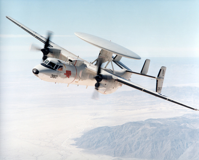 Aerial of an E-2C Hawkeye, Grumman Group 1, VAW-110), Firebirds, Naval Air Station (NAS) Miramar, California, over the San Diego, California area. The E-2C is piloted by Lieutenant (LT) Paulowski and copilot LT Jones, NAS Miramar, California
