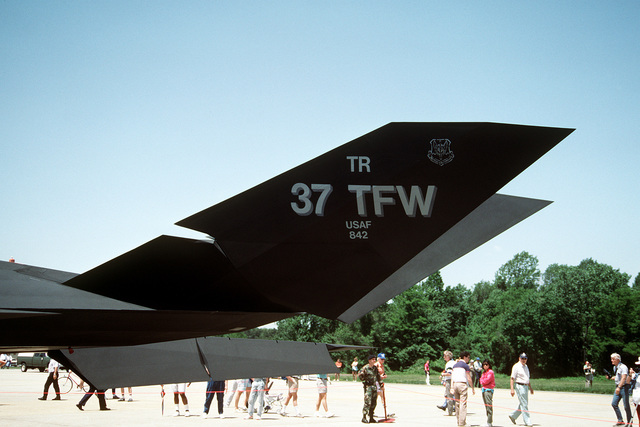 A close-up left side view of the tail section of a 37th Tactical Fighter Wing F-117A Stealth Fighter aircraft on display at the Department of Defense Joint Services Open House