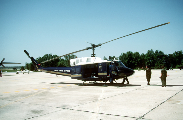 A right side view of an Air Force UH-1N Iroquois helicopter of the 1ST Helicopter Squadron, displayed on the flight line at a Department of Defense Joint Services Open House