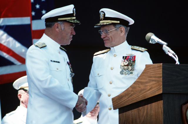 Admiral (ADM) Frank B. Kelso II congratulates ADM Leon A. Edney during the change of command ceremony aboard the aircraft carrier USS JOHN F. KENNEDY (CV 67) at which Edney is assuming Kelso's position as Commander in CHIEF, United States Atlantic Command. Kelso will be replacing ADM Carlisle A.H. Trost as CHIEF of Naval Operations