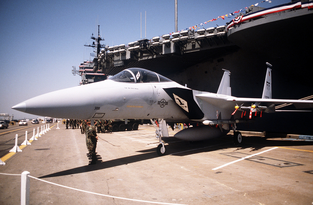 An F-15 Eagle aircraft of the 1ST Tactical Fighter Wing is part of an interservice display mounted for a change of command ceremony aboard the aircraft carrier USS JOHN F. KENNEDY (CV 67). Admiral (ADM) Leon A. Edney assumes command from ADM Frank B. Kelso II as Supreme Allied Commander Atlantic/Commander in CHIEF, United States Atlantic Command