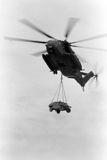 A CH-53E Super Stallion helicopter airlifts an M998 High-Mobility Multipurpose Wheeled Vehicle (HMMWV) during Cobra Gold '90, a combined Thai/U.S. exercise
