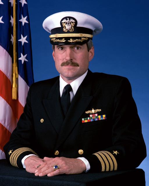 Captain Roland B. Knapp, USN (covered)