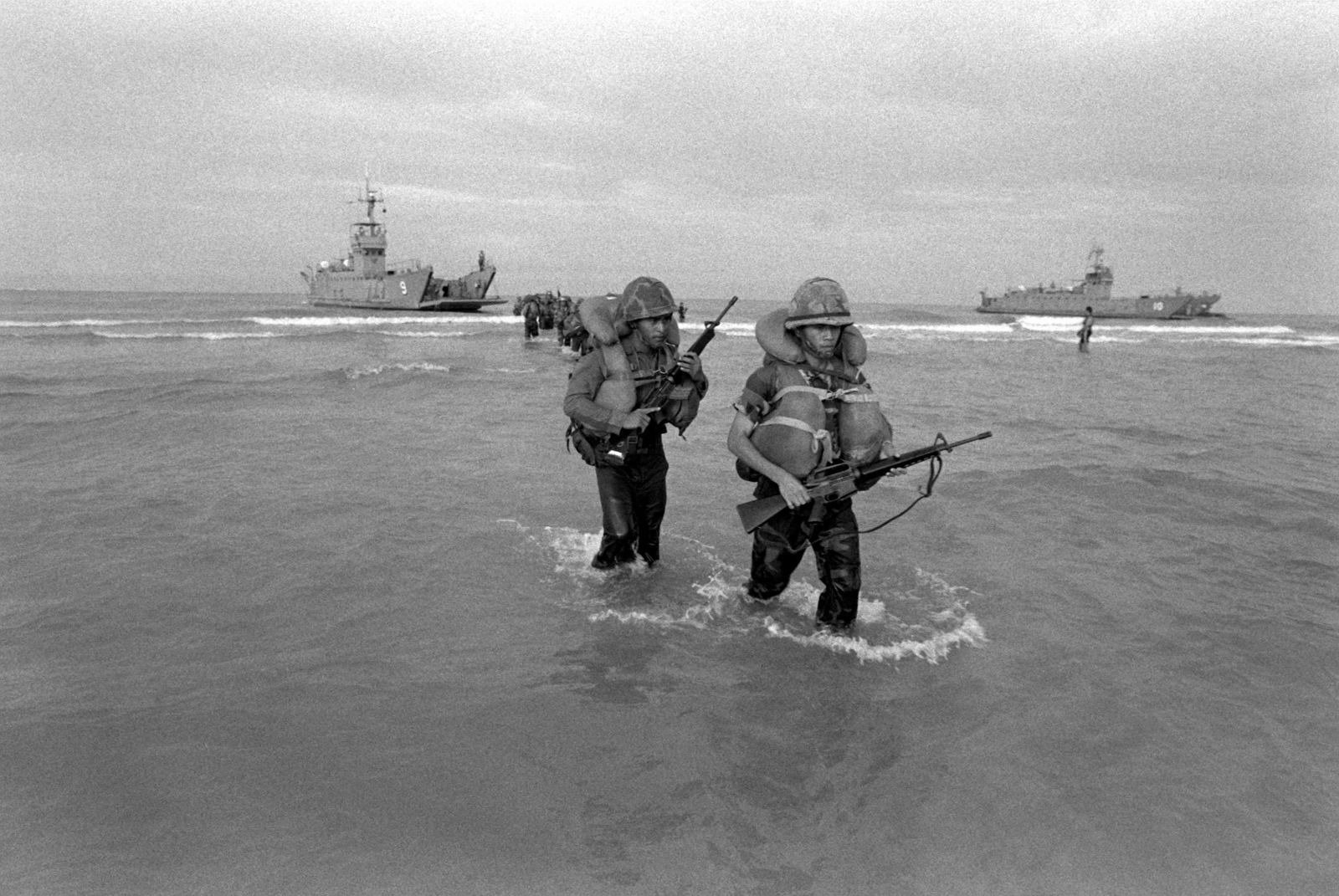 Royal Thai Marines equipped with M-16A1 rifles wade ashore after disembarking from the utility landing craft Wang Nok (LCU-9) during Cobra Gold '90, a combined Thai/U.S. exercise