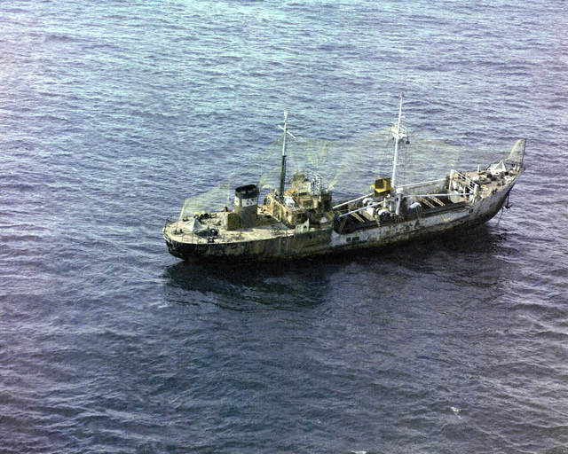 A starboard view of a Soviet Khabarov class cargo lighter in use as a target vessel