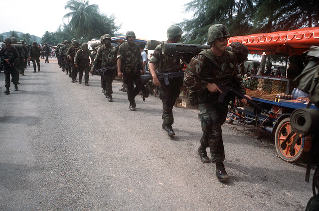 An infantry platoon from the 15th Marine Expeditionary Unit (15th MEU) marches along a road beside the beach during the combined Thai/U.S. exercise Cobra Gold '90