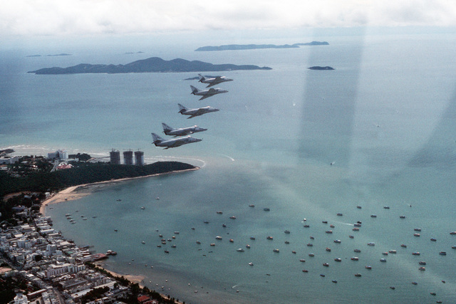 Five A-4E Skyhawk aircraft from Fleet Composite Squadron 5 (VC-5) fly over the coast during the combined Thai/U.S. exercise Cobra Gold '90. The VC-5 detachment is acting as an aggressor unit for the exercise