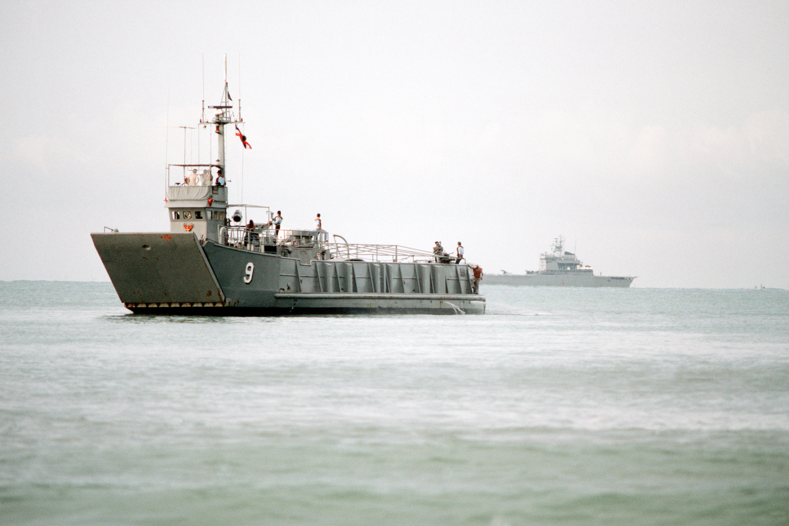 The Thai utility landing craft WANG NOK (LCU-9) approaches the beach during the combined Thai/U.S. exercise Cobra Gold '90. A Thai Normed class tank landing ship is in the background