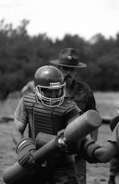 An instructor watches as two soldiers of the 84th Division