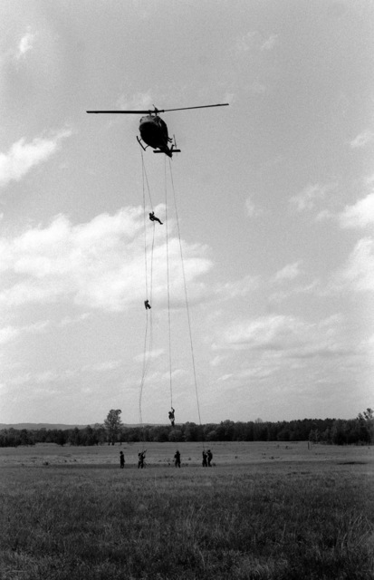"Soldiers rappel from a UH-1 Iroquois helicopter during ""Light Fighter Academy"" air assault training"