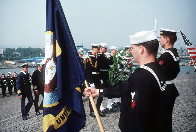 Polish and American sailors take part in a wreath-laying ceremony at a local monument during a visit by crew members of the guided missile cruiser USS HARRY E. YARNELL (CG-17) and the guided missile frigate USS KAUFFMAN (FFG-59). The two vessels are visiting Poland in conjunction with BALTOPS '90, a NATO exercise in the Baltic Sea. Their visit represents the first such port call by American vessels since 1927