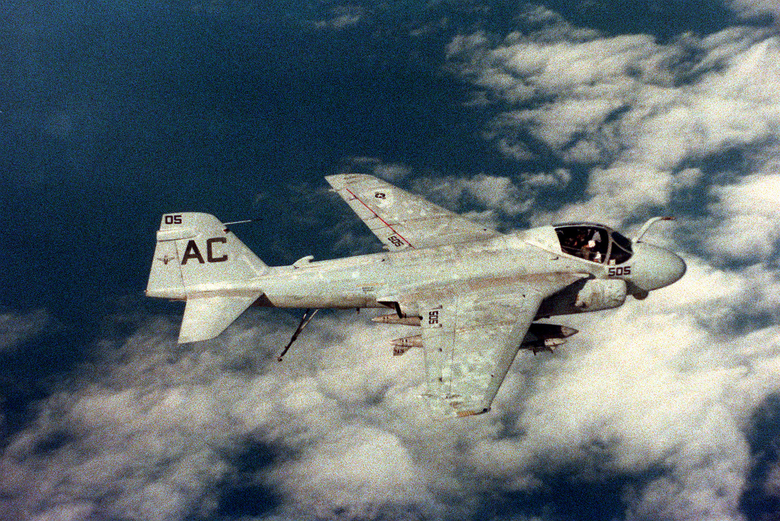 An air-to-air right side view of an Attack Squadron 75 (VA-75) A-6E Intruder aircraft, with tail hook down, preparing to land aboard the aircraft carrier USS JOHN F. KENNEDY (CV-67)