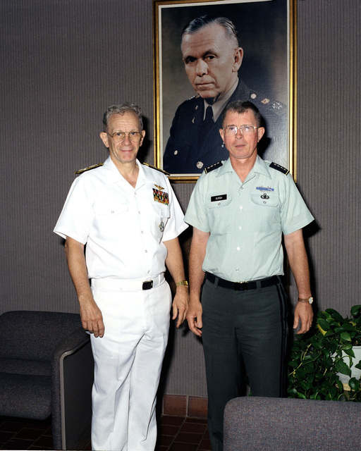 Vice CHIEF of Naval Operations Admiral Leon A. Edney, left, and General Edwin H. Burba Jr., Commanding General, Forces Command (FORSCOM) meet at FORSCOM headquarters. Behind them is a portrait of General of the Army George C. Marshall