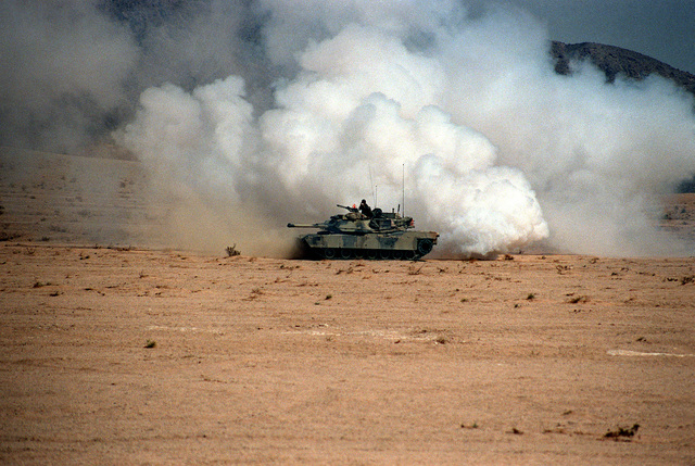 A Blue Forces M-1 Abrams main battle tank lays down a smoke screen during an exercise