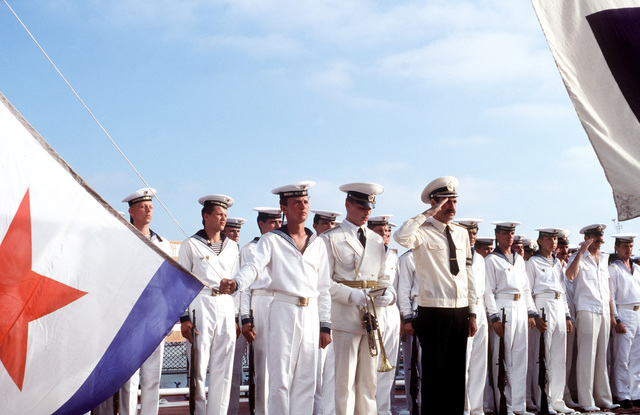 A Soviet sailor stands in front of the ranks as he holds the corner of a naval ensign during a ceremony aboard the Soviet guided missile destroyer ADMIRAL VINOGRADOV. Three ships of the Soviet Pacific Fleet are in San Diego for a five-day goodwill visit