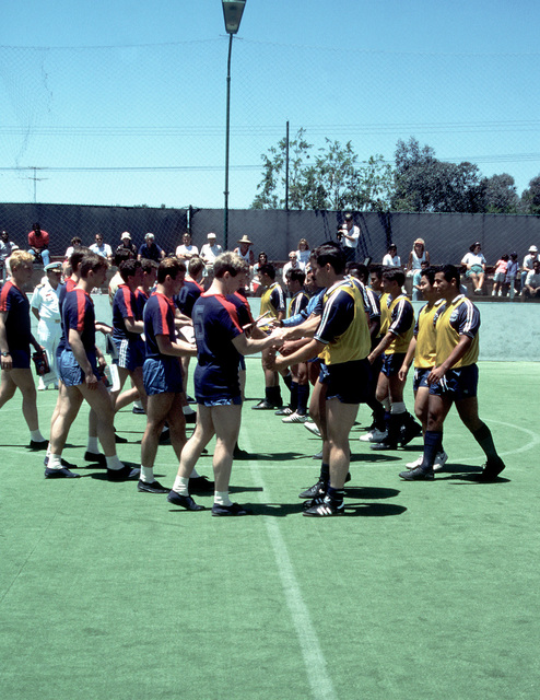 Soviet and American sailors greet each other on the playing field before a soccer match between teams from the two navies. Three ships of the Soviet Pacific Fleet are in San Diego for a five-day goodwill visit