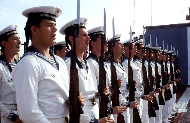 Soviet sailors hold their SKS rifles at present arms as they sing during a ceremony on the flight deck of the Soviet guided missile destroyer ADMIRAL VINOGRADOV. Three ships of the Soviet Pacific Fleet are in San Diego for a five-day goodwill visit