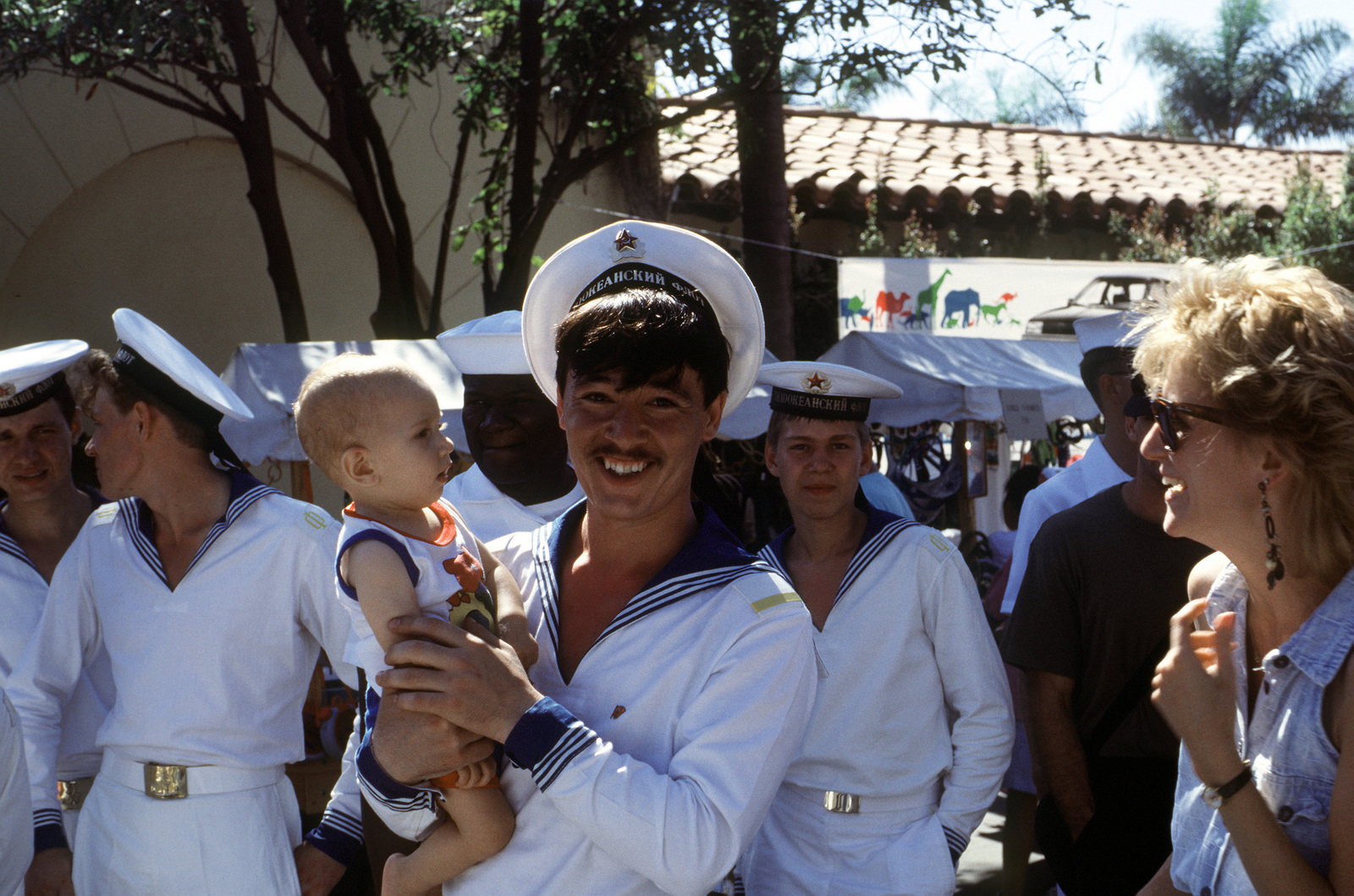 With The Child S Mother Looking On A Soviet Sailor Enjoys Visiting