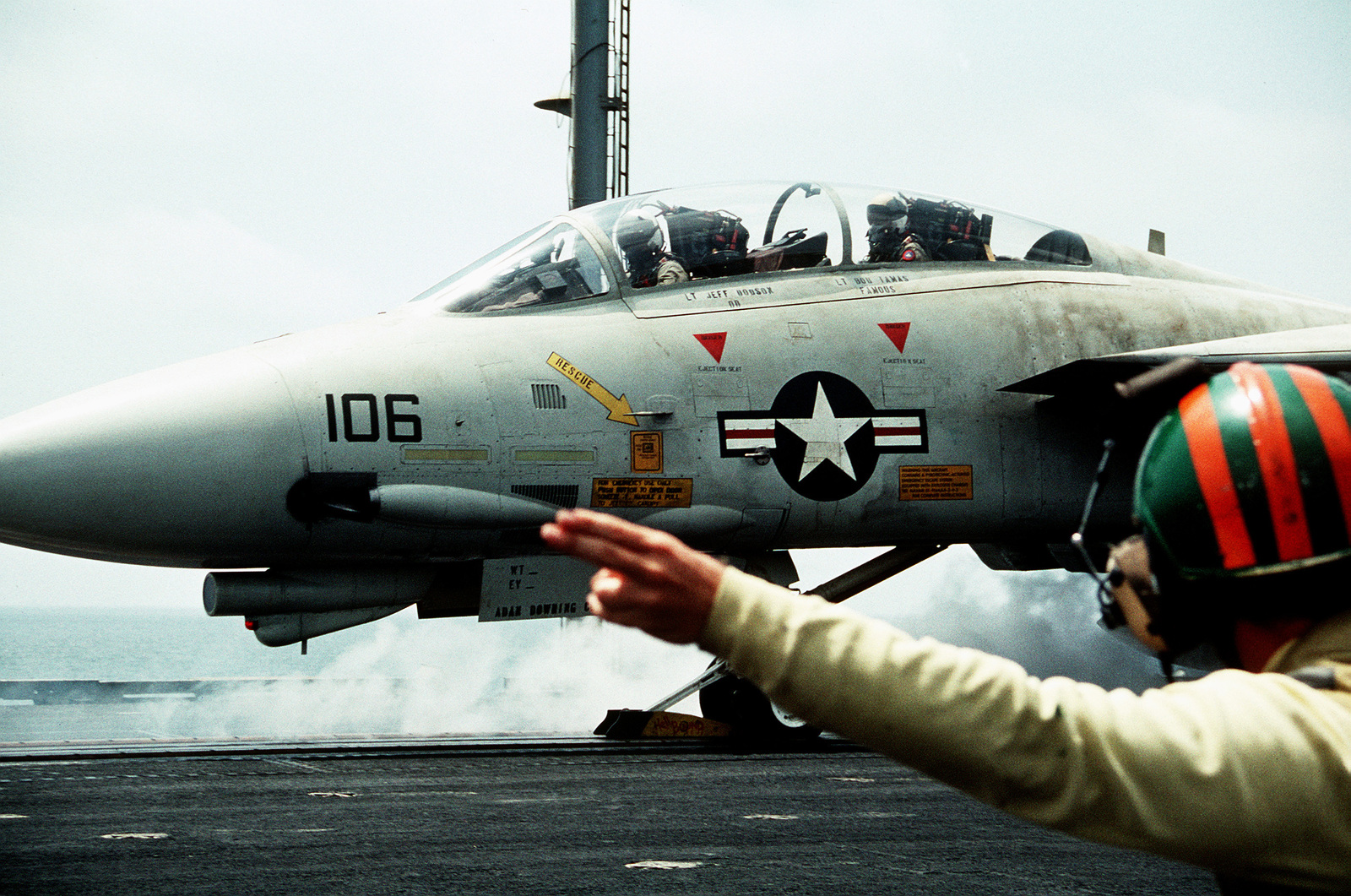 A catapult officer gives the signal to launch an Attack Squadron 196 (VA-196) A-6E Intruder aircraft during flight operations aboard the aircraft carrier USS INDEPENDENCE (CV-62). The INDEPENDENCE is one of the U.S. Navy ships sent to the Persian Gulf in response to Iraq's invasion of Kuwait