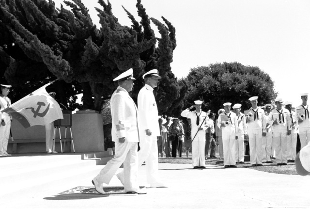 ADM Gennadiy Khvatov, left, commander, Soviet Pacific Fleet, and ADM Charles R. Larson, commander in chief, U.S. Pacific Fleet, take part in a wreath-laying ceremony at Fort Rosecrans National Cemetery. The ceremony is being held to honor those members of the U.S. Merchant Marine who died while delivering supplies to the Soviet Union during World War II. Three ships of the Soviet Pacific Fleet are in San Diego for a five-day goodwill visit