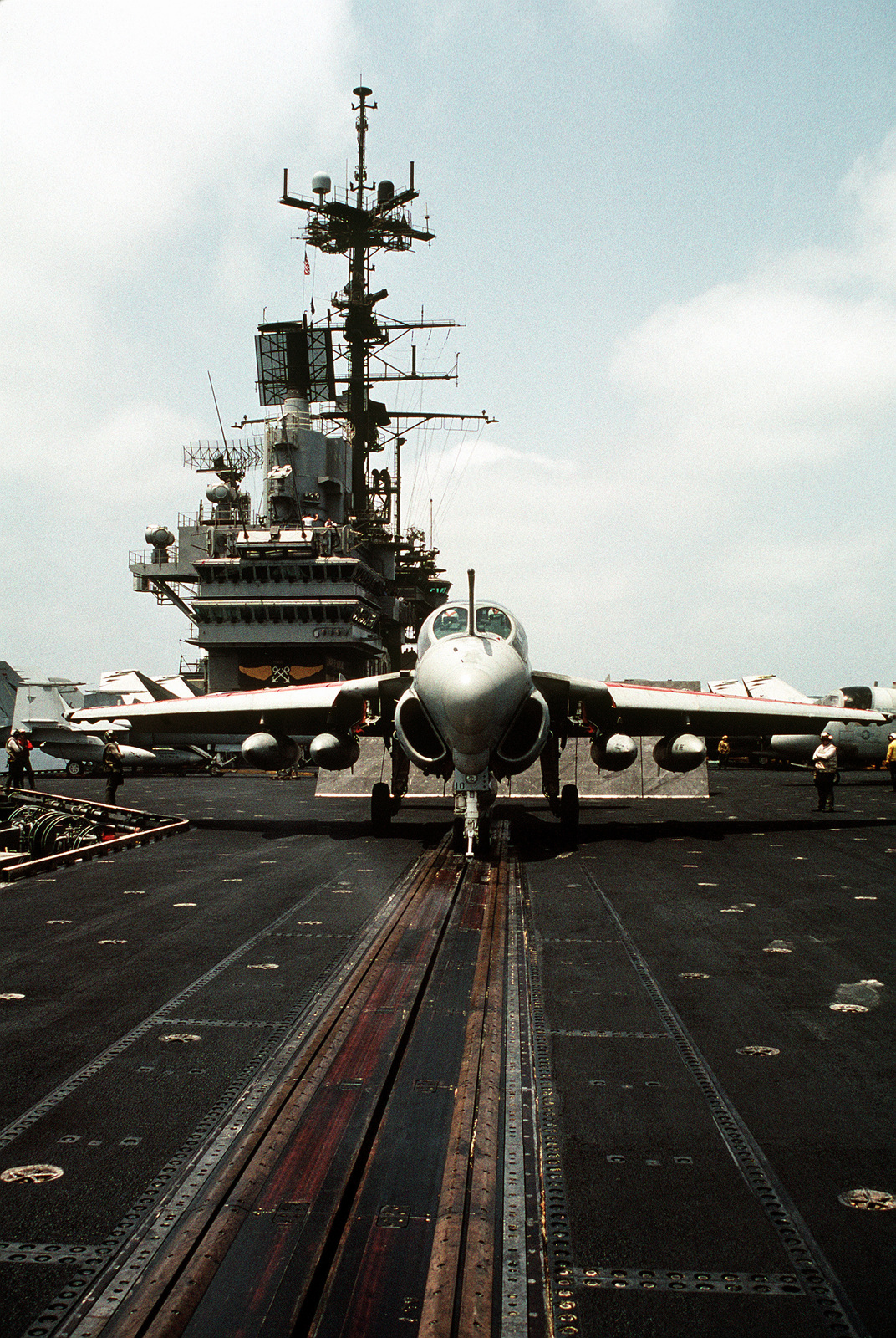 An Attack Squadron 196 (VA-196) A-6E Intruder aircraft sits ready for launch on the No. 1 catapult on the flight deck of the aircraft carrier USS INDEPENDENCE (CV-62) during Operation Desert Shield