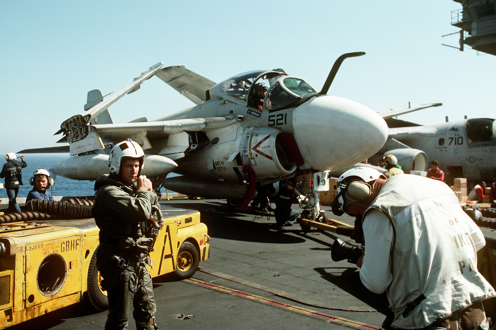 An Attack Squadron 34 (VA-34) A-6E Intruder aircraft flight crewman is videotaped as he walks over to his aircraft on flight deck of the nuclear-powered aircraft carrier USS DWIGHT D. EISENHOWER (CVN-69) during Operation Desert Shield