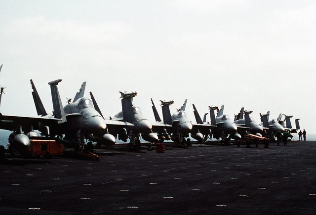 F/A-18C Hornet aircraft of Strike Fighter Squadron 113 (VFA-113) sit armed and ready on the flight deck of the aircraft carrier USS INDEPENDENCE (CV-62). The INDEPENDENCE is one of the U.S. Navy ships sent to the Persian Gulf in response to Iraq's invasion of Kuwait