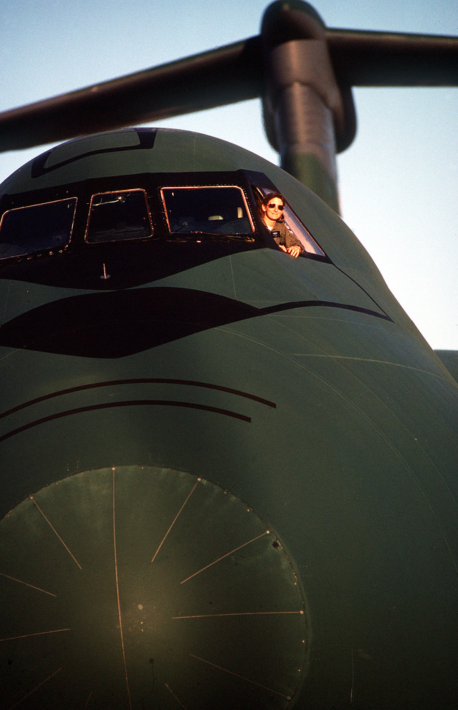 MAJ. Stephanie Wells, a pilot with the 433rd Military Airlift Wing, U.S. Air Force Reserve, sits in the cockpit of a C-5A Galaxy aircraft