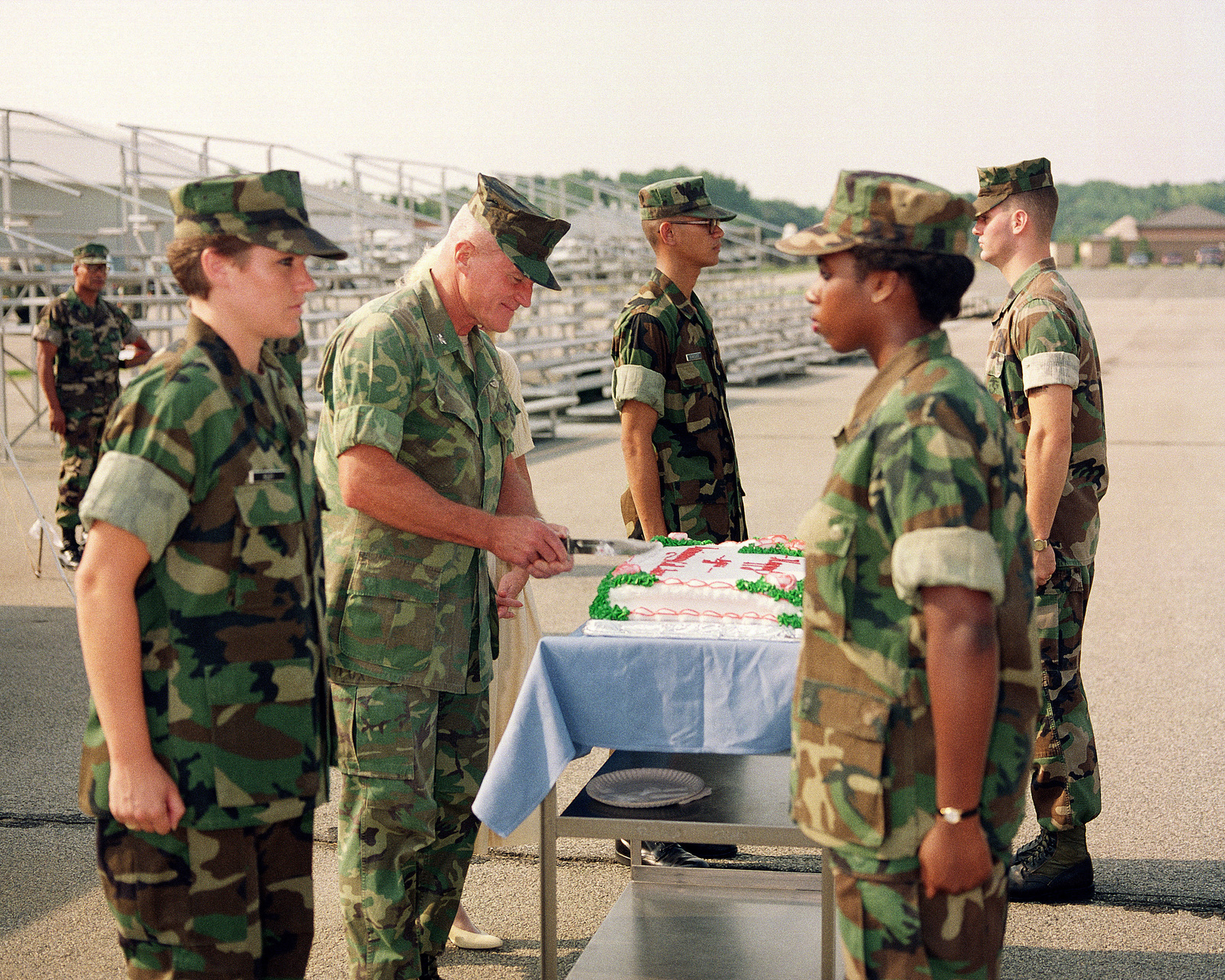 Medal of Honor recipient Colonel (COL) Wesley L. Fox cuts a cake during a celebration of the 40th anniversary of his entry into the Marine Corps. COL Fox enlisted in the Marines on August 4, 1950, and received his commission as an officer on May 27, 1966
