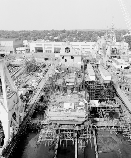 A stern view of the guided missile cruiser Lake Erie (CG 70) on the ways at the Bath Iron Works shipyard. The ship is 40 percent complete