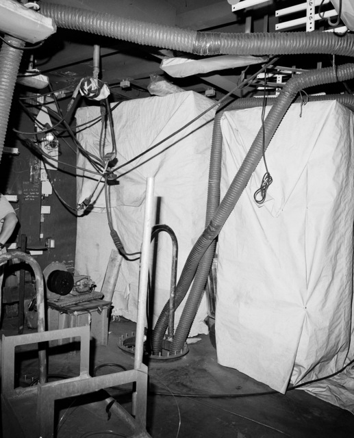A view of the interior communications and gyro room No. 2 aboard the guided missile cruiser Lake Erie (CG 70). The ship is 40 percent complete at the Bath Iron Works shipyard