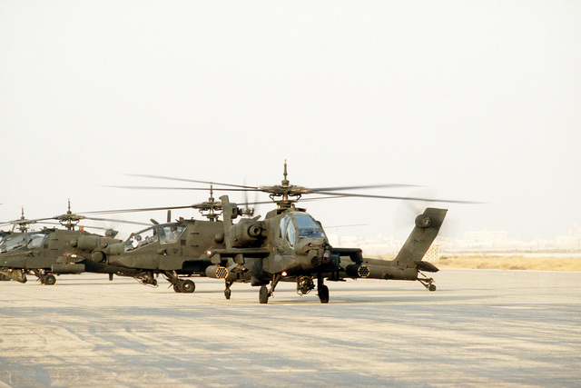 Two AH-64 Apache helicopters depart for a training flight during Operation Desert Shield